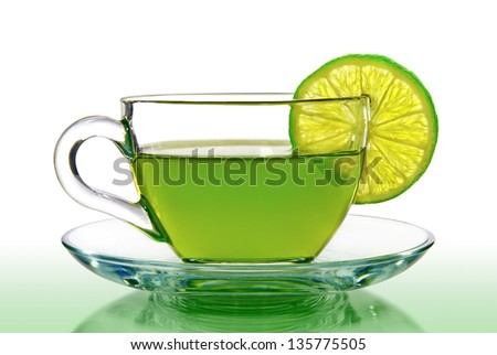 Green tea with lemon on a white background. - stock photo