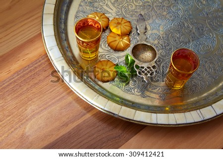 green tea with mint Moroccan style on silver tray and biscuits - stock photo