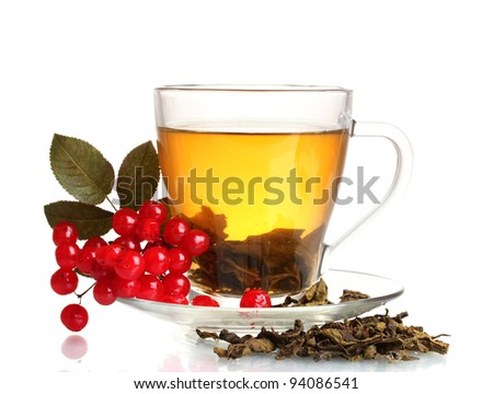 Green tea  with red viburnum in glass cup isolated on white - stock photo
