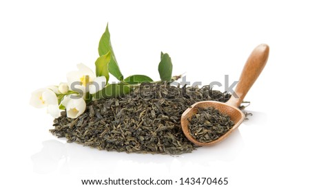 Green tea, wooden spoon and branch of the blossoming jasmine, isolated on white - stock photo