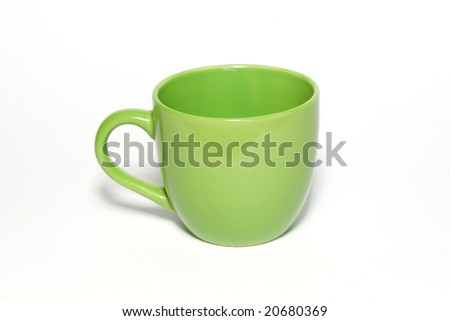 Green teacup isolated in white