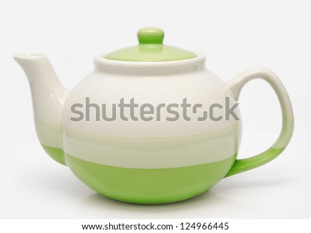 Green teapot isolated on a white background