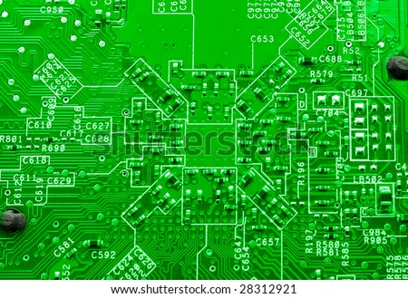 Green technology: motherboard macro background - stock photo