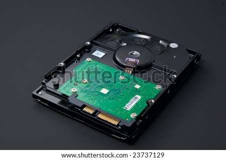 Green technology: serial ata (SATA) hard drive isolated on black