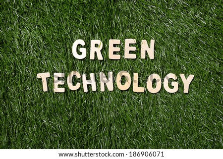 Green technology wooden sign  on green grass background