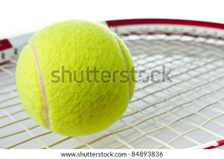 Green tennis ball on the racket on isolatd