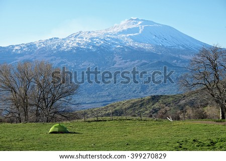 green tent and volcano Etna from Nebrodi Park, Sicily - stock photo