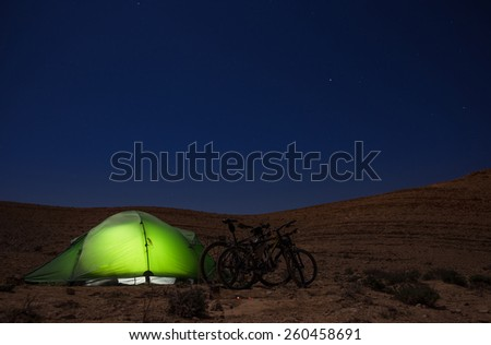 Green tent lighting at night - stock photo