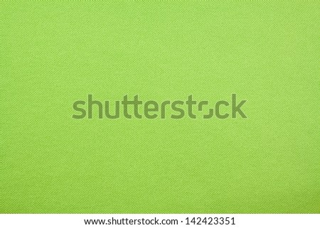 green textile fabric background texture or pattern of clothing