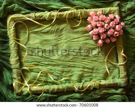 Green textile frame with yellow ribbon and rose heart - stock photo