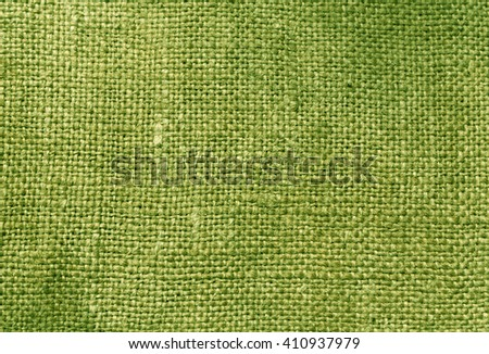 Green textile sack texture. Background and texture for design. - stock photo