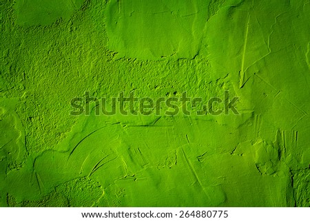 Green texture background with bright center spotlight - stock photo