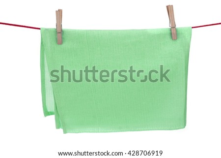 Green Textured Towel Hanging On A Red Rope  Isolated On A White Background With Copy Space. You can use this image as signboard. - stock photo