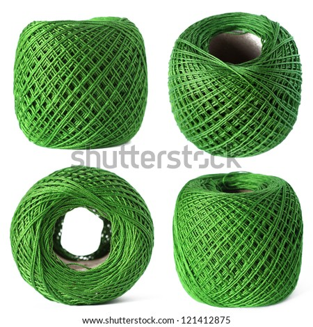 Green thread clew set isolated on white background - stock photo