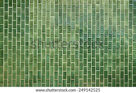 Green tiled wall - stock photo