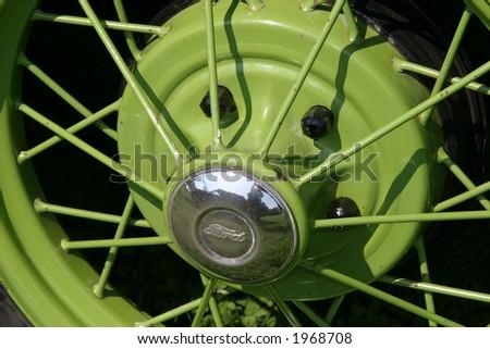 Green Tire Spokes Vintage Car - stock photo