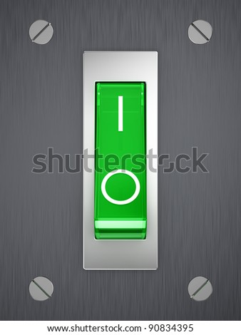 Green toggle switch on metallic surface - stock photo
