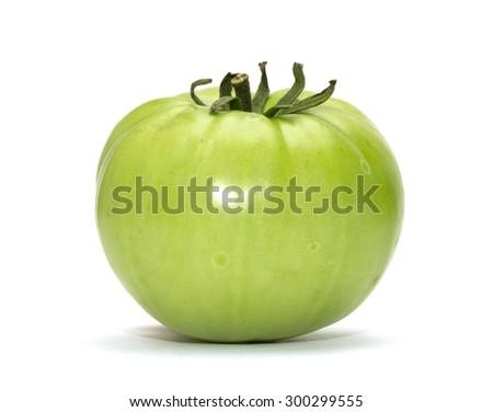 green tomato on white background - stock photo