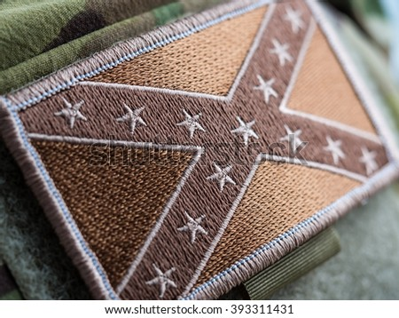 Green toned Combat Confederate Flag patch close-up, shallow depth of field - stock photo