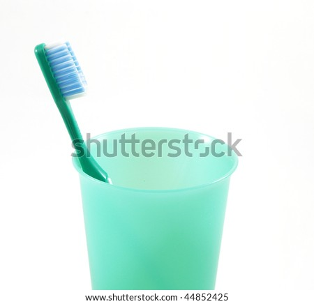 Green toothbrush and dish