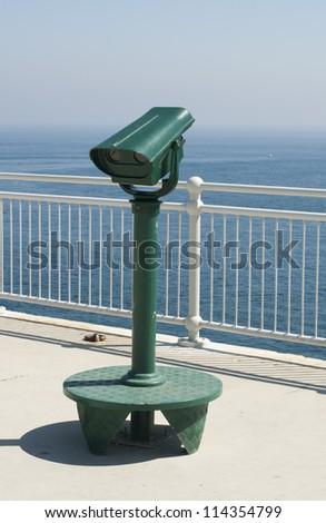 Green tourist telescope. Sea view and sky - stock photo