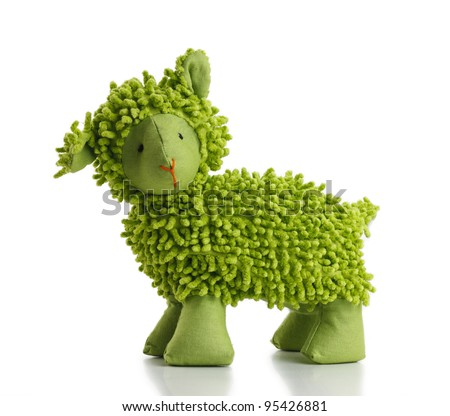 Green toy sheep on white background. - stock photo