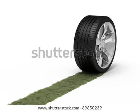 Green trace from a wheel. Ecological concept. - stock photo