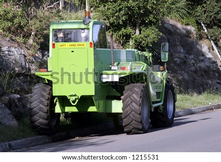Green Tractor - Crane On The Road - Back View
