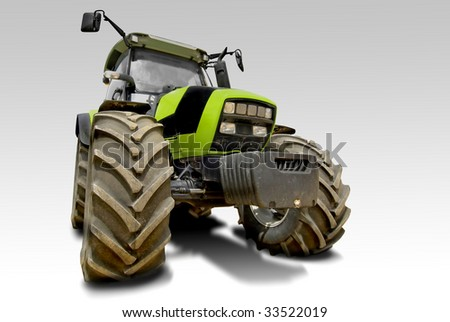 Green tractor isolated in white - stock photo