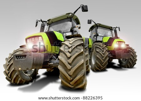Green tractors isolated in a light background - stock photo