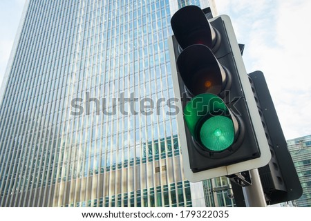 Green Traffic Light in the city, London  - stock photo