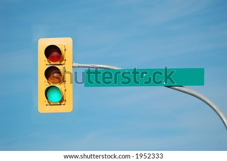 Green traffic light with blank sign. - stock photo