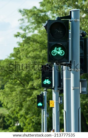 Green traffic lights for bicycles in a row. - stock photo
