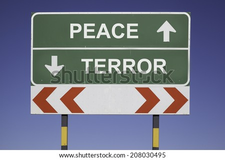 green traffic sign in front of a blue sky, horizontal arrows showing two directions and a red white road warning post. Political concept for the relations between Nations or people: Peace or Terror - stock photo