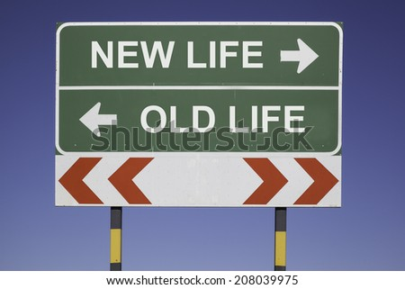 green traffic sign in front of a blue sky, horizontal arrows showing two directions and a red white road warning post. Business concept for activity and decision: New life or old life - stock photo