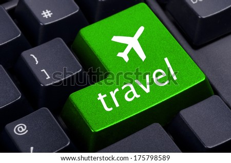 green travel  button  on the black keyboard  - stock photo