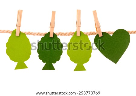 green trees and heart paper shapes hanging on a rope clothesline isolated on white - stock photo