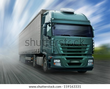 Green Truck on Highway - stock photo