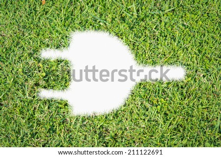 Green turf logo power plug made of green grass - stock photo