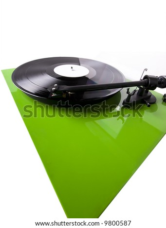 Green turntable playing a record isolated on white. Wide angle shot