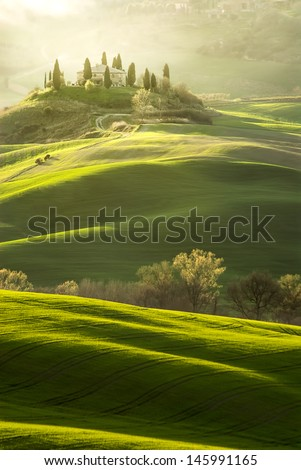 Green Tuscany hill and village - stock photo