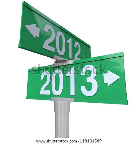 Green two-way road signs pointing from 2012 to 2013 to symbolize change to new year - stock photo