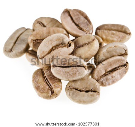 green unroasted coffee beans isolated on white background