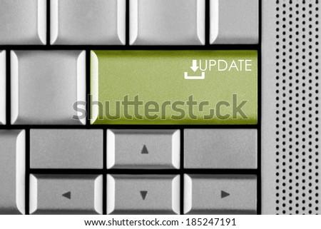 Green UPDATE key on a computer keyboard  - stock photo