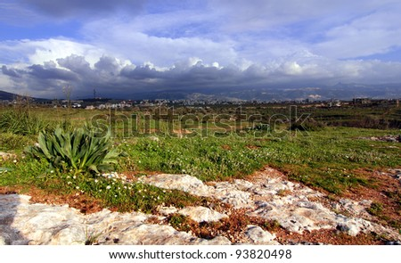 Green valley and thunderstorm clouds above the mountains, Tripoli, Lebanon - stock photo