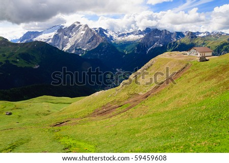 Green valley in Dolomites in summer. - stock photo