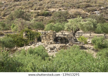 Green valley on the south side near Matala and Kalamaki invites to hike on Crete. An old former refuge is along a hiking trail. The trail leads from Pitsidia to Kalamaki - stock photo