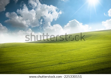 Green Valley with blue cloudy sky