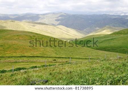 Green valley with mountains. California, USA - stock photo
