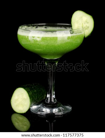 Green vegetable juice isolated on black